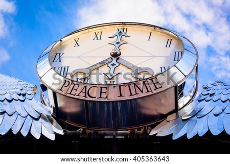 Glastonbury, Somerset, UK - June 28, 2015 - Glastonbury Festival's Pyramid Stage Clock - Peace Time - stock photo