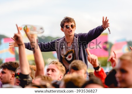 Glastonbury, Somerset, UK - June 26th 2015: Festival goer enjoying The Courteeners performing on the Other Stage at Glastonbury Festival 2015. - stock photo
