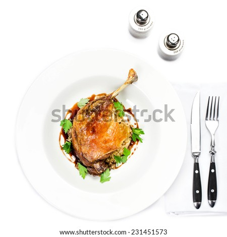 Glazed Christmas roast duck seasoned with oil, herbs, fig and aniseed sauce in a white plate  - stock photo