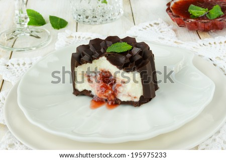 Glazed cottage cheese with berry jam on white background - stock photo