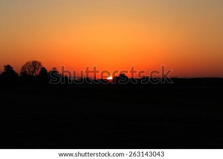 gleam of dark summer decline above Earth - stock photo