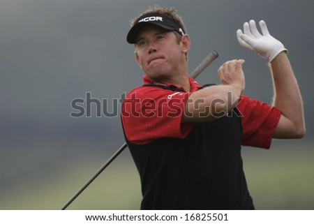 GLENEAGLES SCOTLAND AUGUST 28, Engfland's Lee Westwood loses his club after teeing off whilst competing in the Johnnie Walker Classic PGA European Tour golf tournament at Gleneagles  Scotland - stock photo