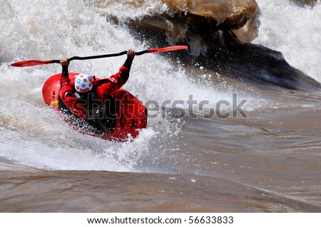 GLENWOOD SPRINGS, CO - JUNE 8: World Freestyle Kayak (K1) Champion Emily Jackson in action on the Colorado River June 8, 2010 in Glenwood Springs, CO. - stock photo