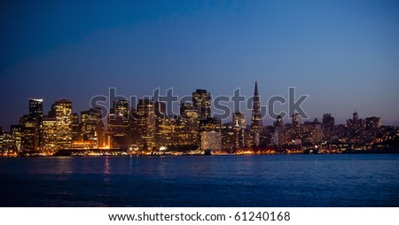 glimmering downtown next to the transamerica pyramid buiding - stock photo