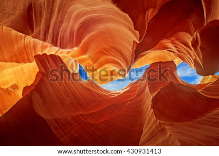 glimpse of blue sky over the antelope slot canyon - stock photo