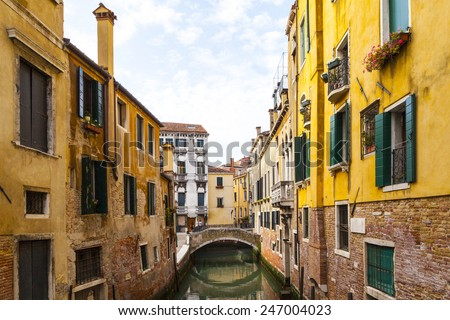 Glimpse of Venice - Italy, Europe - with the flag of Venice  - stock photo