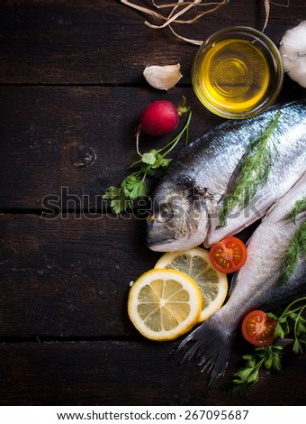 Glithead fishe head and tail with ingredients and blank space  - stock photo