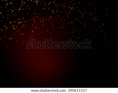 glitter in shades of gold, orange and red above a dark background with a red highlight - stock photo