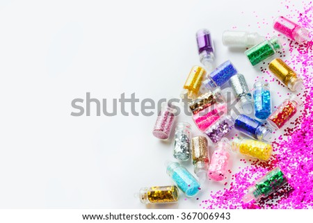 Glitter makeup and manicure, beautiful makeup accessories on a white background. Beauty background - stock photo