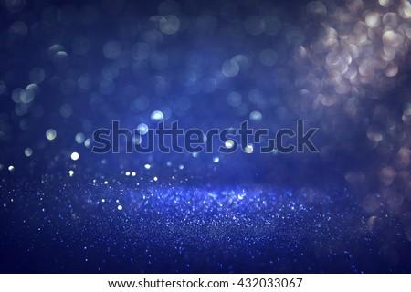 glitter vintage lights background. black, silver and blue. defocused  - stock photo