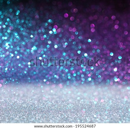 glitter vintage lights background. blue and purple. defocused - stock photo