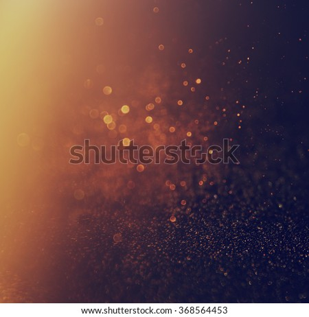 glitter vintage lights background. gold and black. defocused.  - stock photo