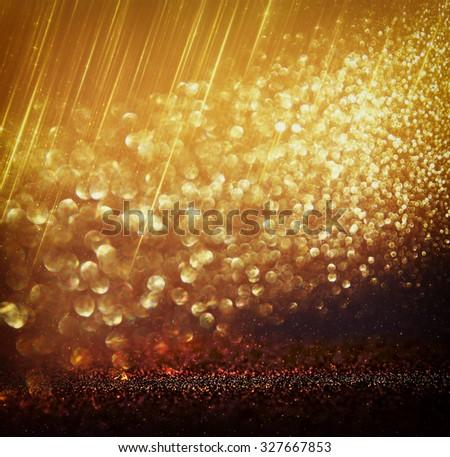 glitter vintage lights background. gold, silver, and black. de-focused.  - stock photo