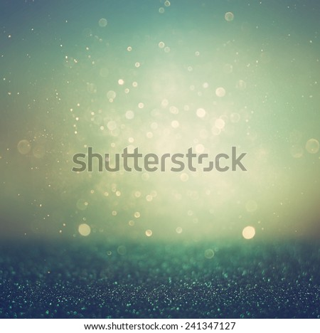 glitter vintage lights background. gold, silver, blue and black. de-focused.  - stock photo