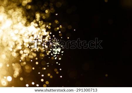 glitter vintage lights background. light gold and black. defocused. - stock photo