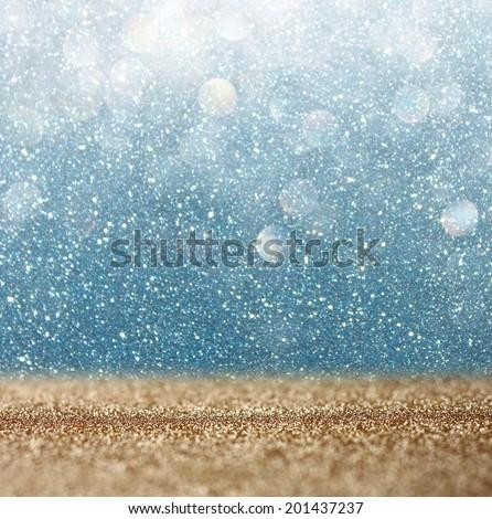 glitter vintage lights background. light gold and blue. defocused.  - stock photo
