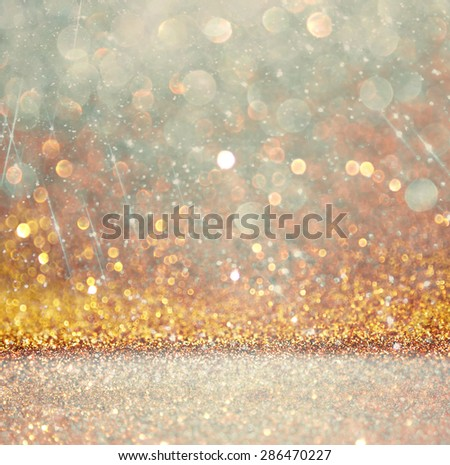 glitter vintage lights background. light gold and silver. defocused.  - stock photo