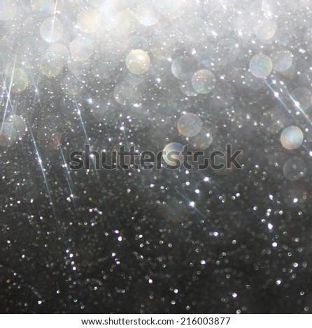 glitter vintage lights background. light silver and black. defocused.  - stock photo