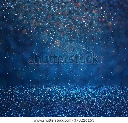 glitter vintage lights background. light silver, gold, blue and black. defocused.  - stock photo