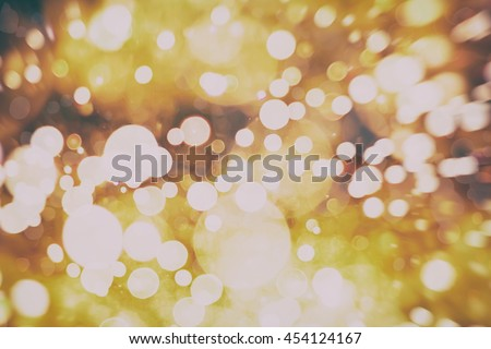 glittering shine bulbs lights background:blur of Christmas wallpaper decorations concept.holiday festival backdrop:sparkle circle lit celebrations display. - stock photo