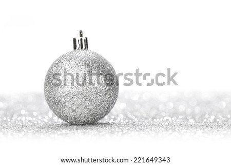 Glittering silver Christmas ball with in shiny glitters background - stock photo
