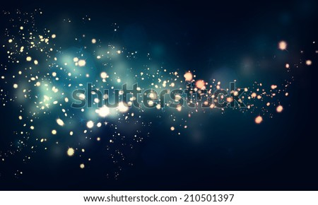 glittering stars on dark background - stock photo