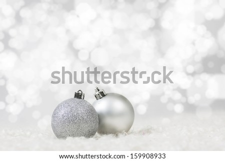 Glittering Xmas Decoration Baubles Against Shiny Background - stock photo