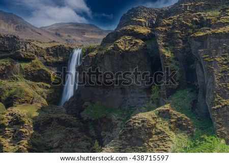 Gljufrabui (Canyon dweller) waterfall. A waterfall that falls in a hidden narrow gorge along the former (glacial period) coastline of. Southern Iceland - stock photo