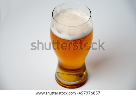 Gllass of light beer isolated on a white background - stock photo