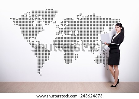 Global business concept - business woman using laptop computer with world map - stock photo