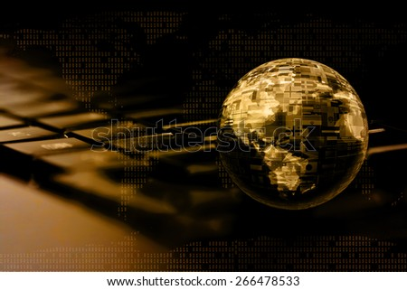 Global business concept. Glass globe with world map and flags on computer keyboard.  - stock photo