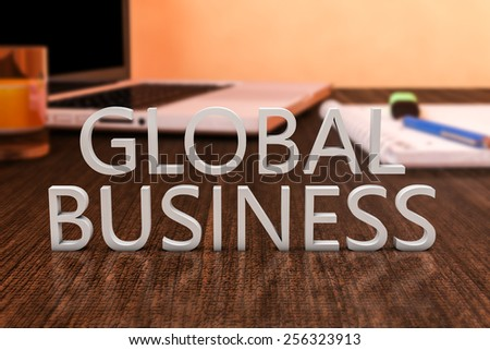 Global Business - letters on wooden desk with laptop computer and a notebook. 3d render illustration. - stock photo