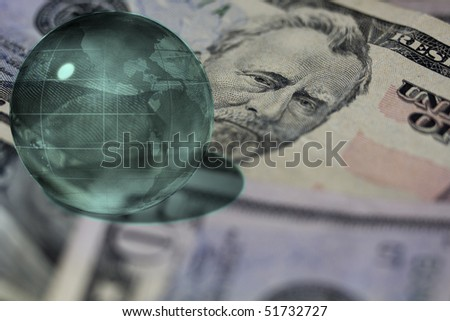 Global Business with US Currency and Glass Sphere of the World - stock photo