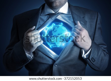 Global Businessman. A businessman revealing a connected world. Business concept - stock photo