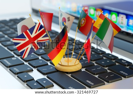 Global communication and business concept, translate and e-learning, national flags of the world countries on computer laptop keyboard - stock photo