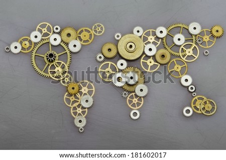 Global cooperation. World map formed by gears - stock photo