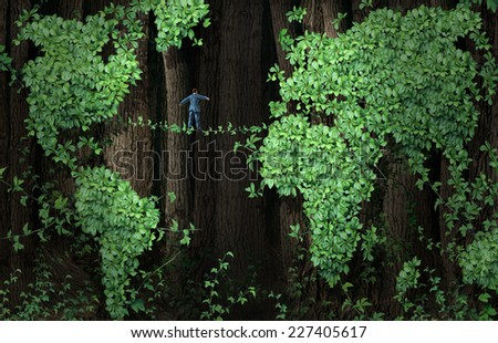 Global growth risk business concept as a businessman walking on a tightrope made from plant vines in a forest of tree leaf vine shaped as a world map as an international trade uncertainty metaphor. - stock photo