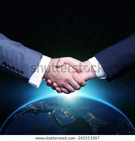 Global Handshake Globe night view Elements of this image furnished by NASA - stock photo