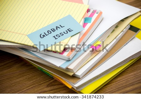 Global Issue; The Pile of Business Documents on the Desk - stock photo