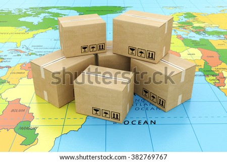 Global logistics, shipping and worldwide delivery business concept: heap of stacked corrugated cardboard boxes with parcel goods on the world map - stock photo