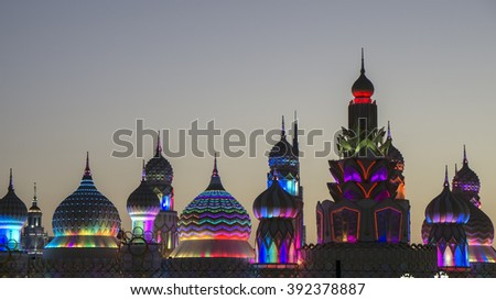 GLOBAL VILLAGE, DUBAI, UNITED ARAB EMIRATES - JANUARY 26, 2016 : Brightly coloured shops and pavilions inside Global Village have helped make this one Dubai's most popular visitor attractions.   - stock photo