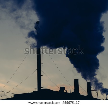 Global warming concept smokestack. Chimney. Toned image - stock photo