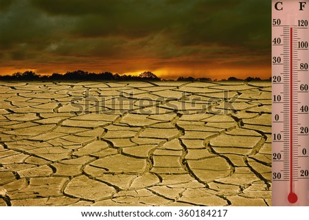 Global warming is a real threat for our civilization. Conceptual image symbolizing drastic changing in climate of our planet - stock photo