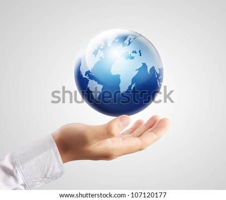 Globe ,earth in human hand - stock photo