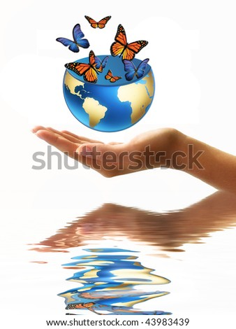 globe full of butterflies in hand - stock photo