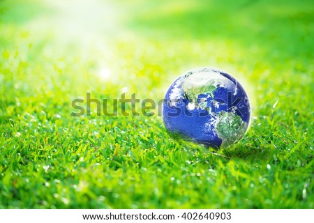 Globe in the garden, Earth on green grass eco concept, Elements of this image furnished by NASA - stock photo