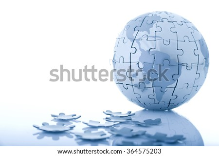 Globe jigsaw puzzle while some parts dropped. Isolated on white background with drop shadow. - stock photo