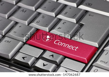 Globe key to connect to the world. Red key with a world map showing the America's and the word 'Connect' - stock photo