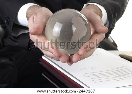 Globe made of glass in hand - stock photo