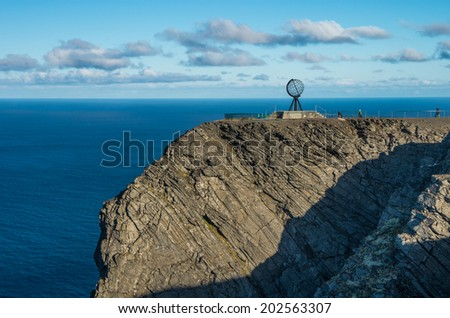 Globe monument at Nordkapp,  the northern point of Europe, located in the north of Norway - stock photo